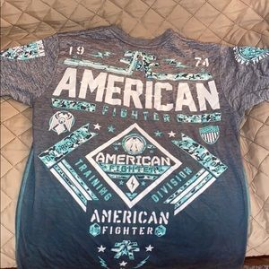 We are selling a men's American fighter t shirt